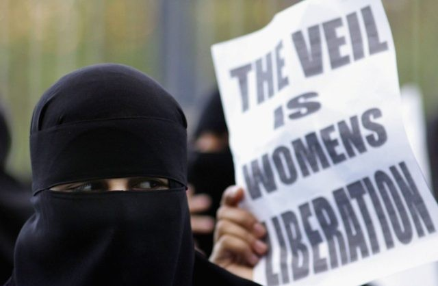 "Protest against France's much-debated ""burqa ban"" new law, which prohibits the wearing of Islamic body-covering burqas in all public spaces in France."