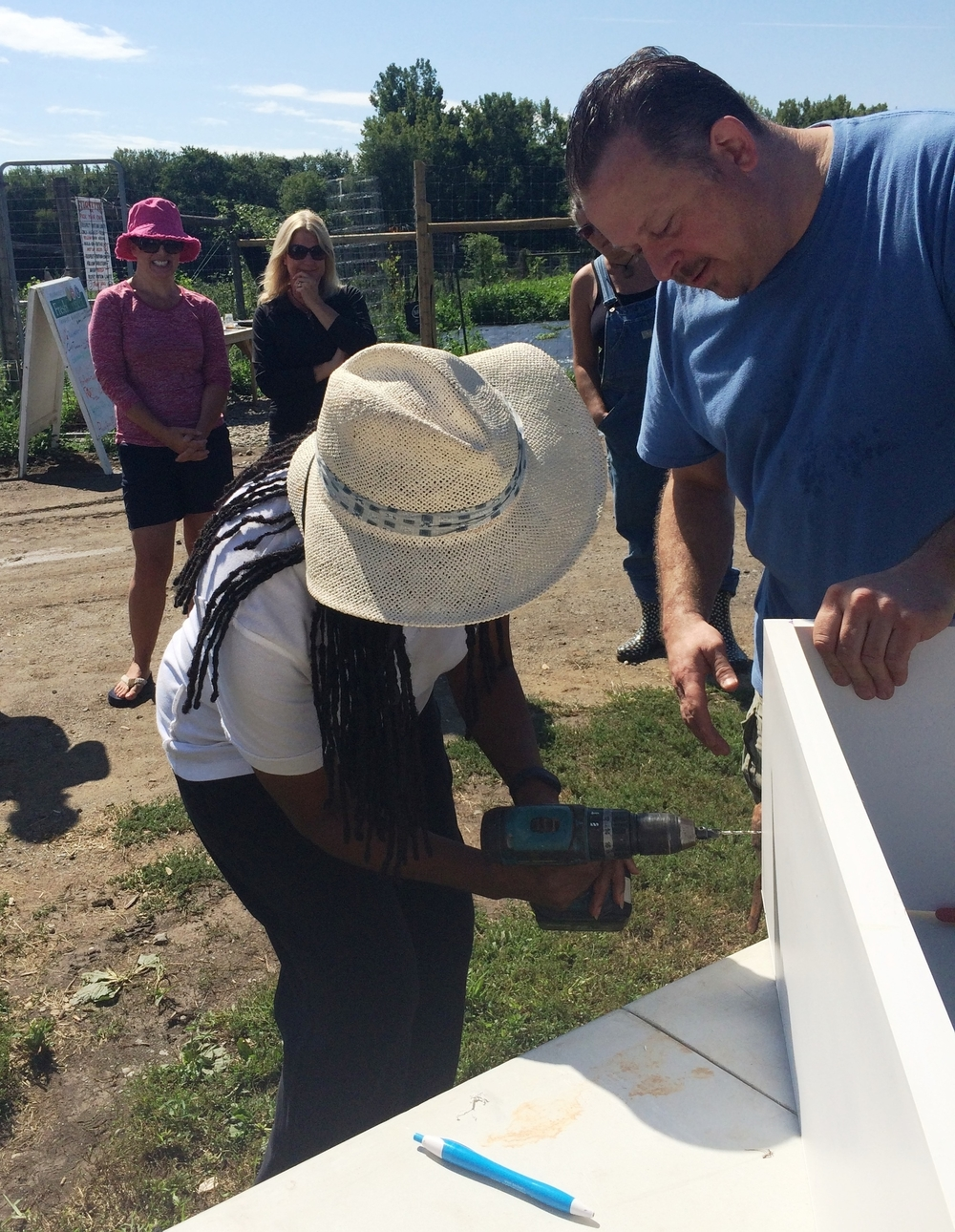 Ozie Williams of the  Dutchess County Health Department  builds a raised garden bed out of PVC boards at PFP's 2015 Summer Institute.