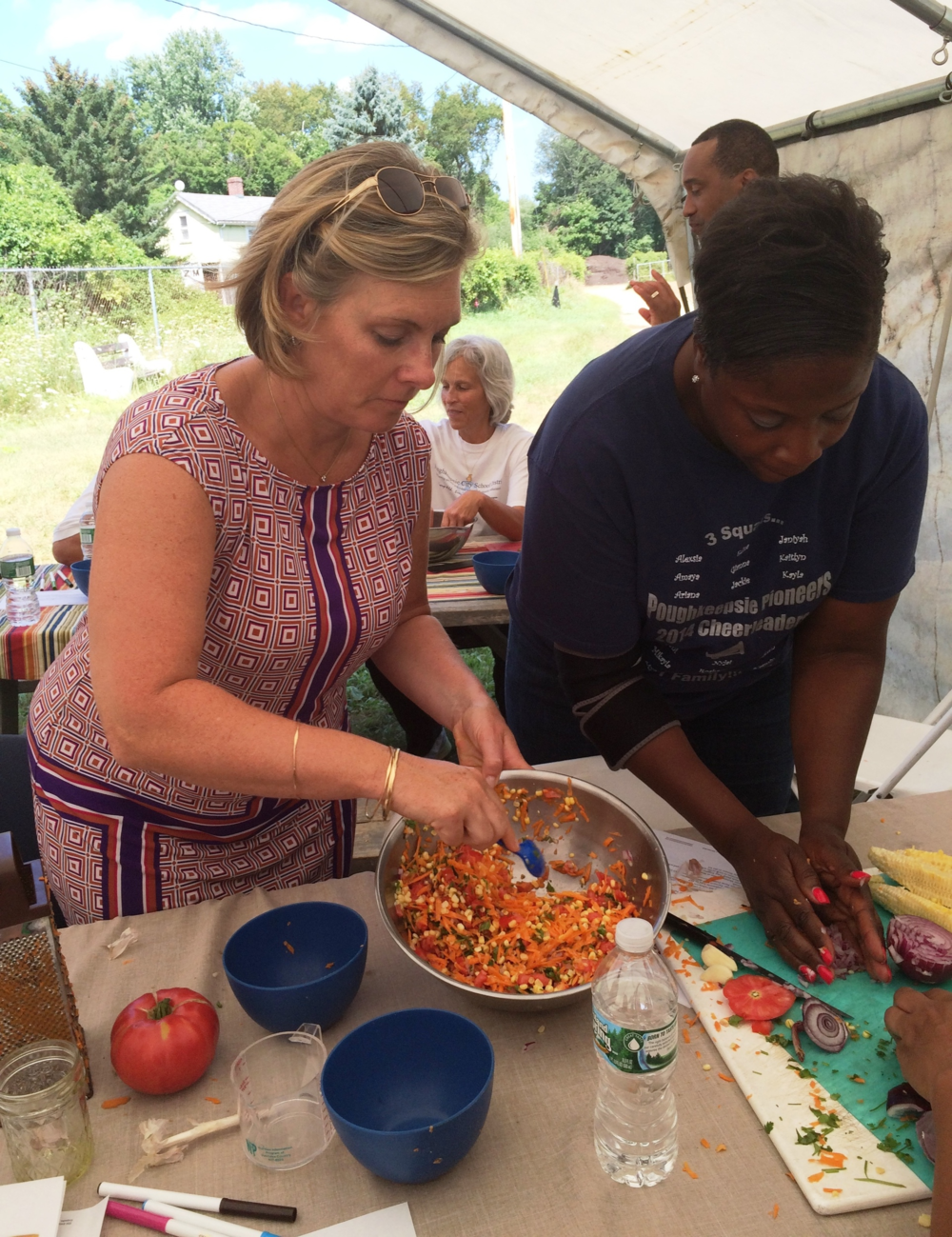 Poughkeepsie City School District principals, Andrea Moriarty and Nadine Dargan, compete against their colleagues to prepare delicious vegetable-based snacks at a PFP workshop on nutrition.