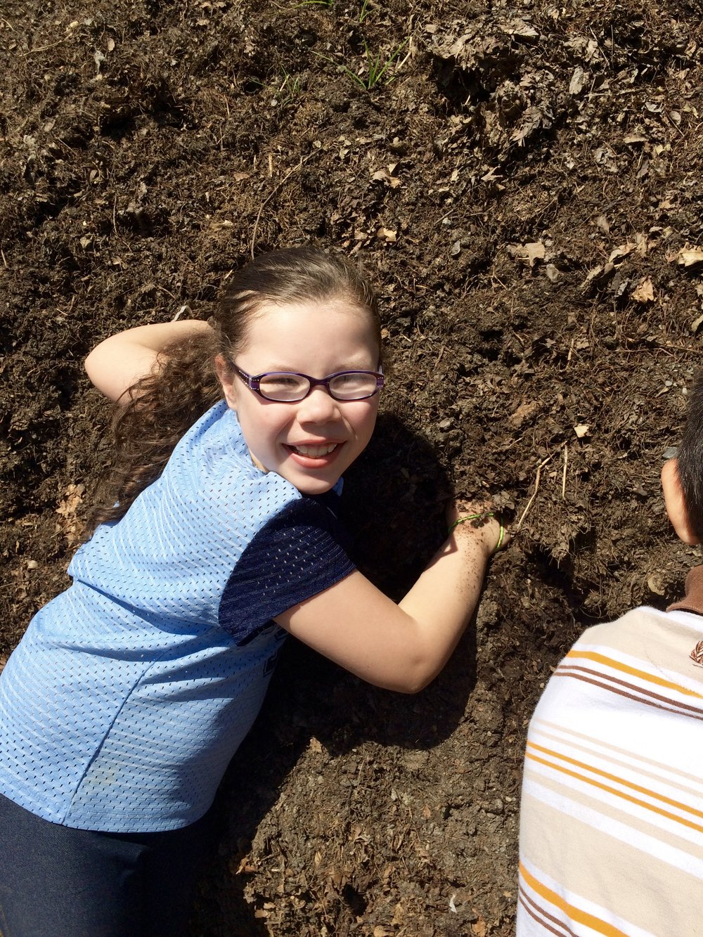 Visiting 2nd graders took turns reaching into the giant compost pile to feel the warmth of decomposing leaves inside.