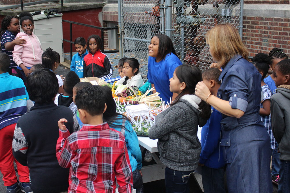Clinton students get ready to sample some locally-grown snacks.