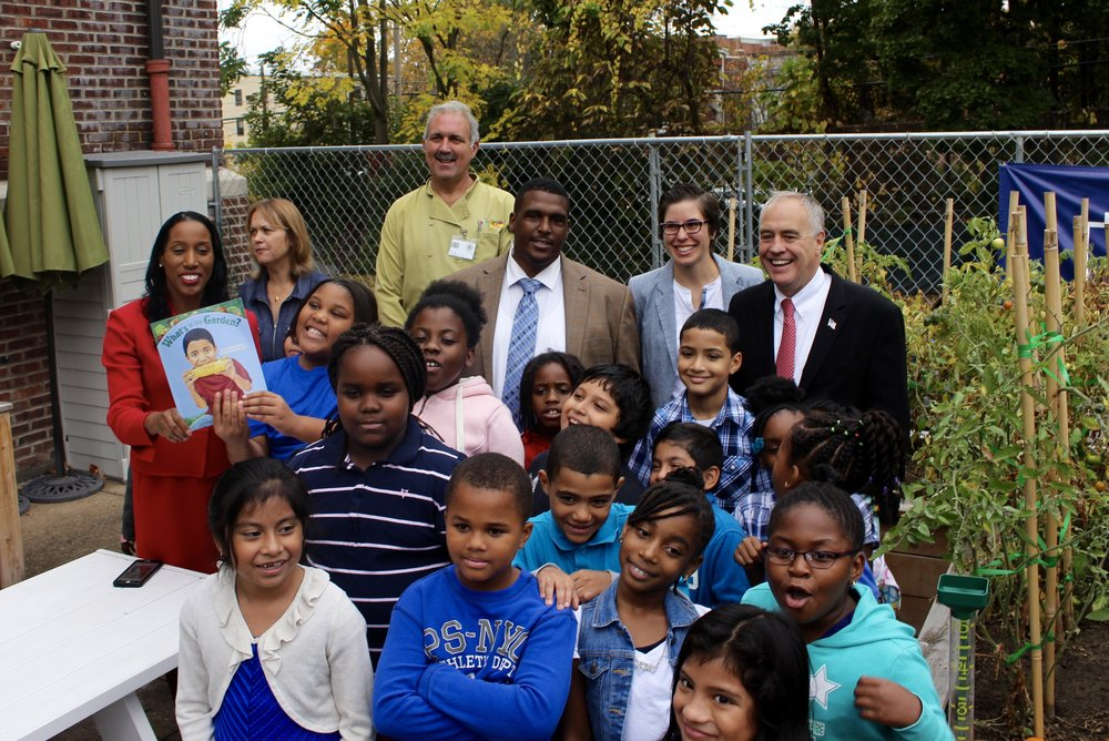 Clinton students show Mr. DiNapoli their school garden.
