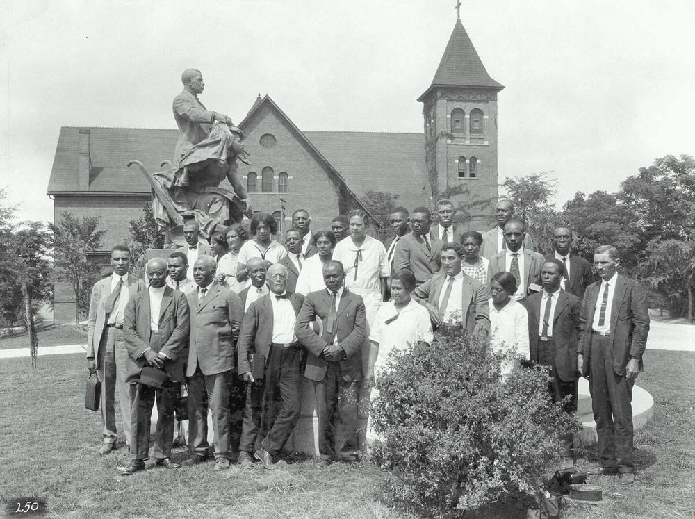African-American farm and home demonstration agents pose for a group photograph under the Booker T. Washington monument at Tuskegee Institute, July 15, 1925:  Wikipedia