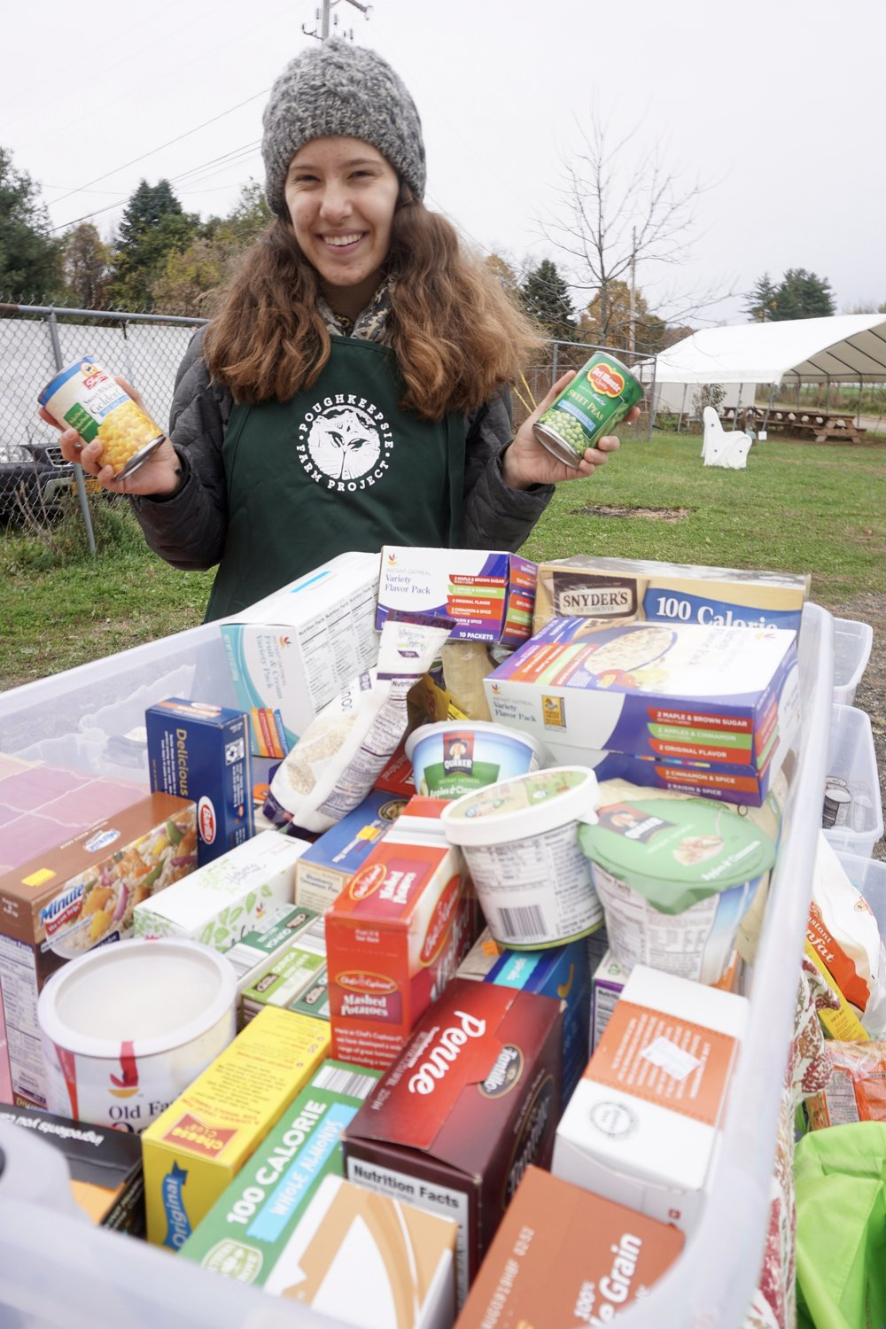 PFP Intern Lucy holds up some newly donated cans of veggies!