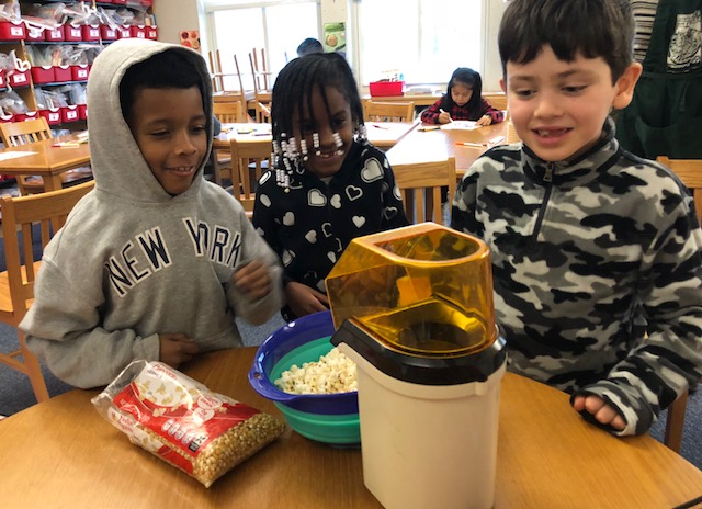 Krieger students learn about flavors and decide how to season their popcorn.