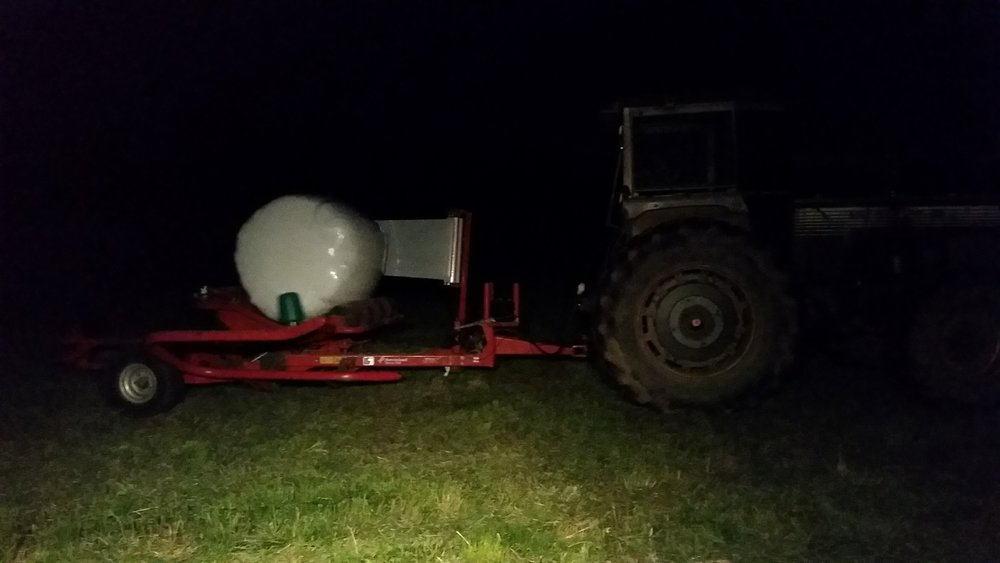 Wrapping our bales late at night