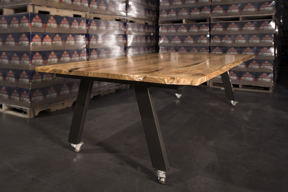 WAREHOUSE TABLE siberian elm top  • •  powdercoated steel base  • •  with locking Casters