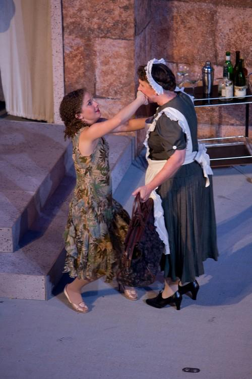 Julia hastily hushes Lucetta in Two Gentlemen of Verona at Oklahoma Sheakespeare in the Park. Directed by Kathryn McGill, Scenic Design by Rick Reeves, Costumes by Robert Pittenridge.