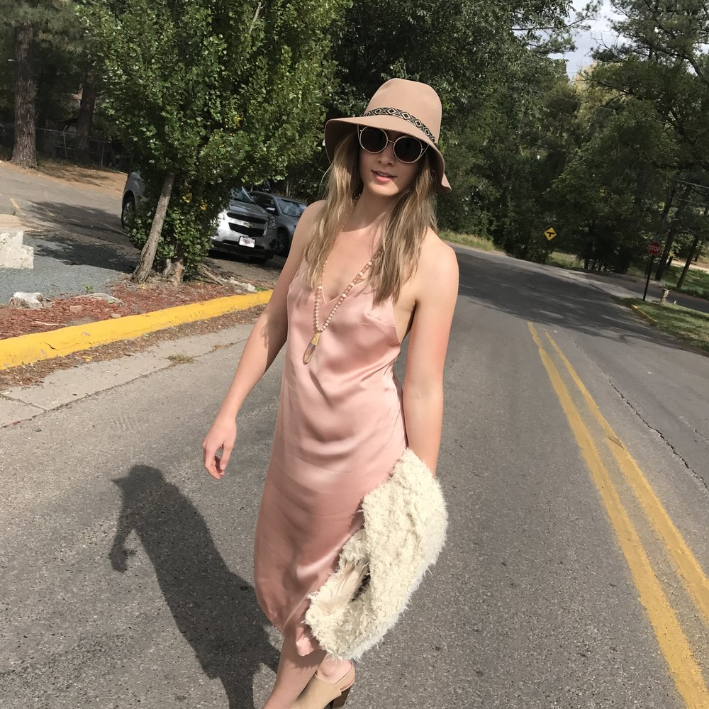 Polished Boho   Choose a sleek slip dress and a vest in a soft shape and luxurious texture.  This look is a play on  contrast , the straight, long lines of the dress against the soft natural feel of the vest.  Love = Boho Babe Deluxe! dress $53 / vest $55 XOXO. J·Roberts