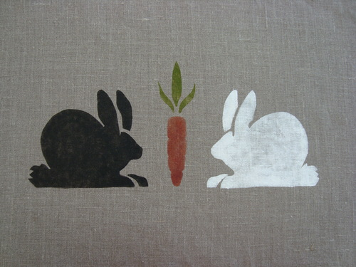 "Above, Hungry Rabbits eyeing a carrot. The black and white rabbits are on Enzyme Washed Linen. The stencil is 14"" wide. $42.00 per motif."