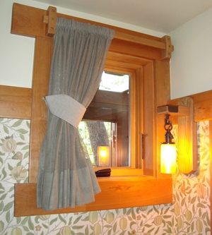 A hold back can lift a curtain away from the window to let in more light.