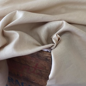"Enzyme washed linen: a natural Belgium linen faded to a beautiful slightly uneven lighter taupe, 54"" wide, $26.00 per yard."
