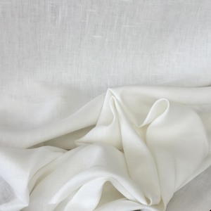 "Handky Linen, Oyster:  slightly off-white woven with a fine thread so that it can support applique or Roman shade structure. Should not be lined, 55"" wide. $25.00 per yard."