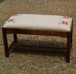 The Checkerberry here again on this Arts & Crafts piano bench is terra cotta and loden on natural linen.
