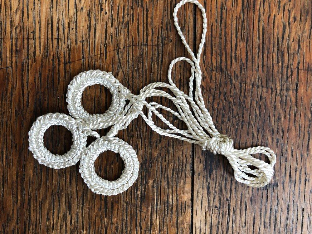 ecru crocheted pulls.jpg