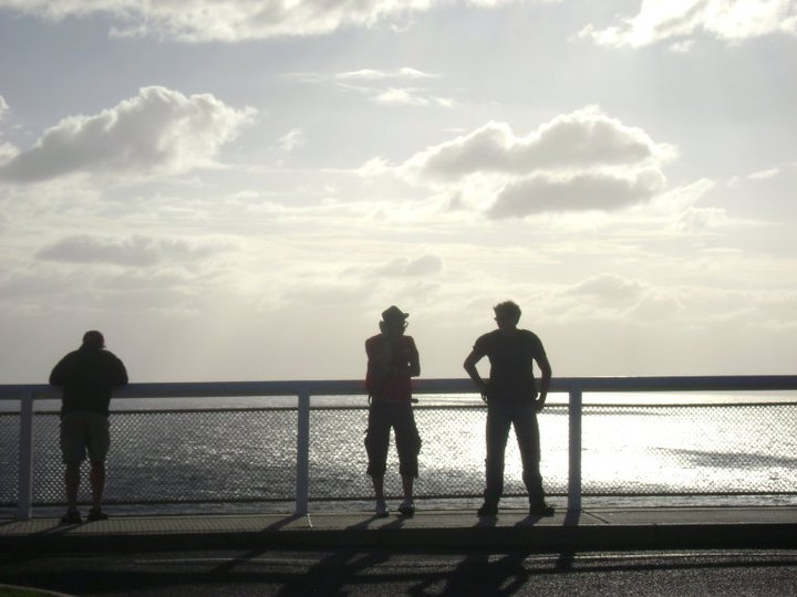 Brandon, a European guy we met, and David standing on the edge of Australia