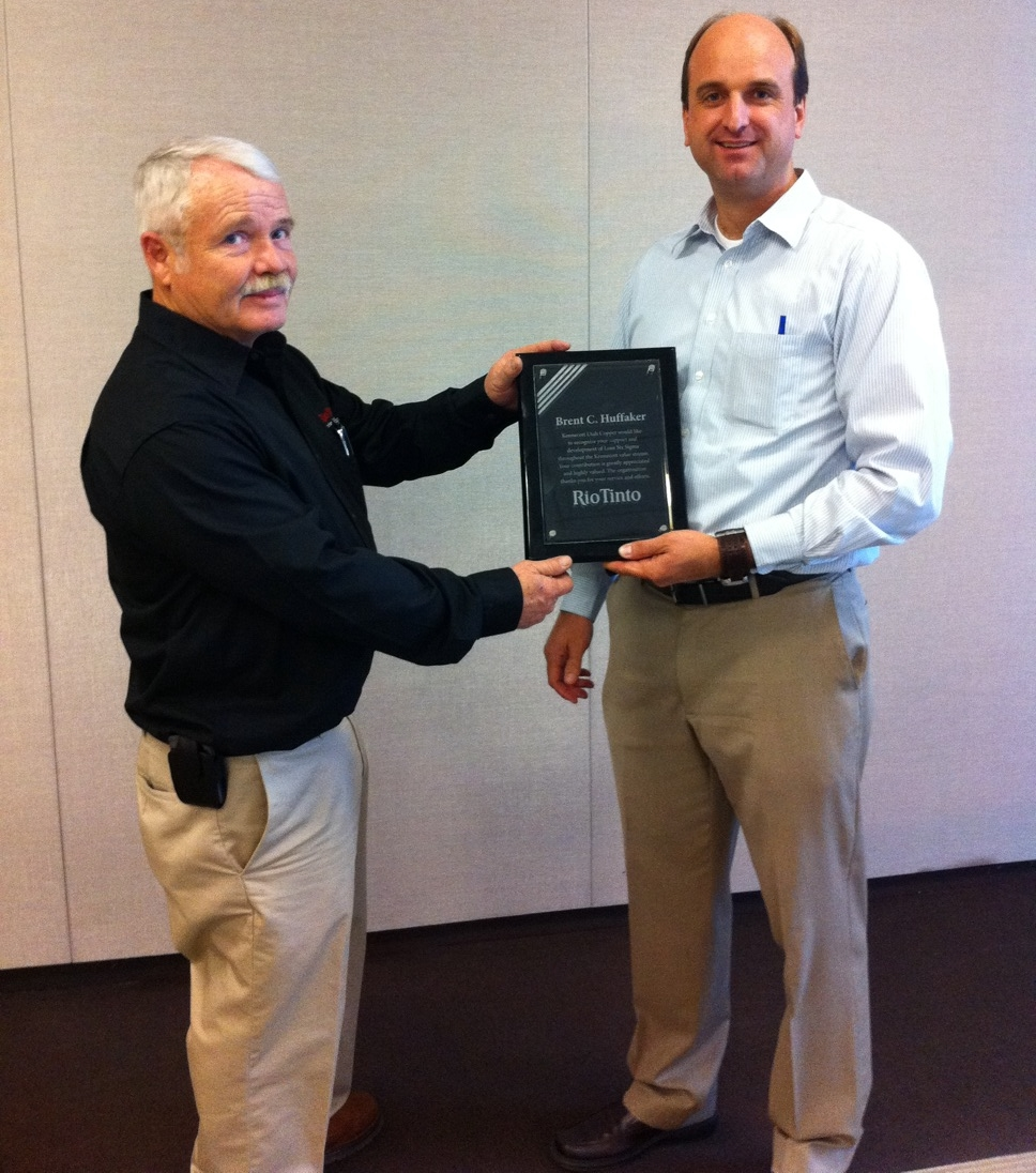 Right: Brent Huffaker receiving reward from Rio Tinto in 2011 for support & development of Lean Six Sigma throughout the Kennecott value stream