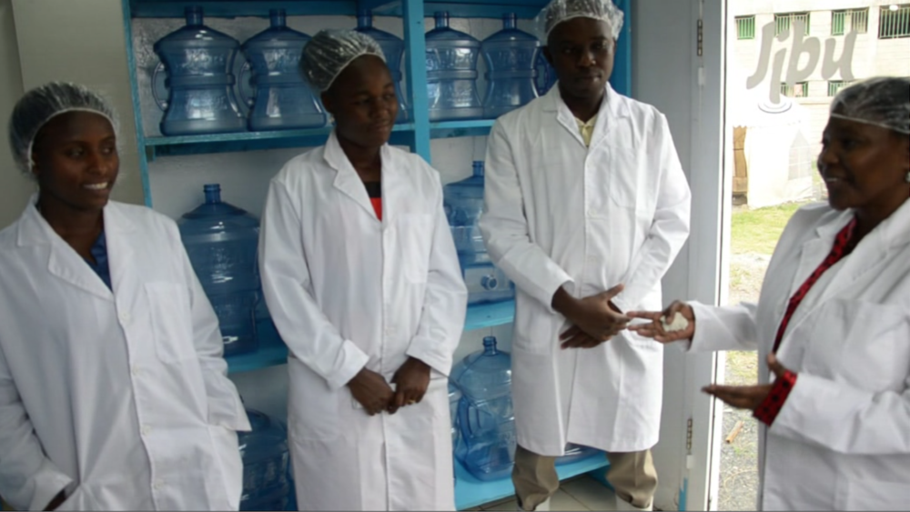 "In Josephine's words (pictured far right), ""Jibu is the solution to the water crisis in our community."""