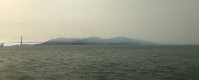Smoky view of the Golden Gate Bridge from Fort Mason at SOCAP17
