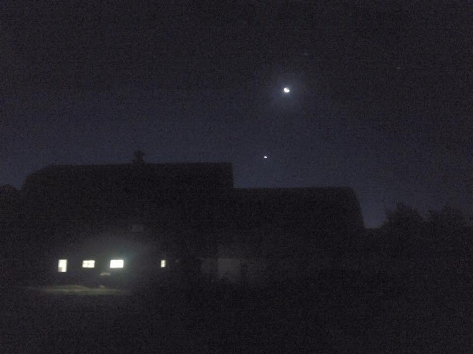 the moon, stars, and barn making their own constellation