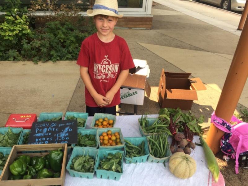 Otto's market stand at St. Croix Falls Farmers Market.  All harvested by him!