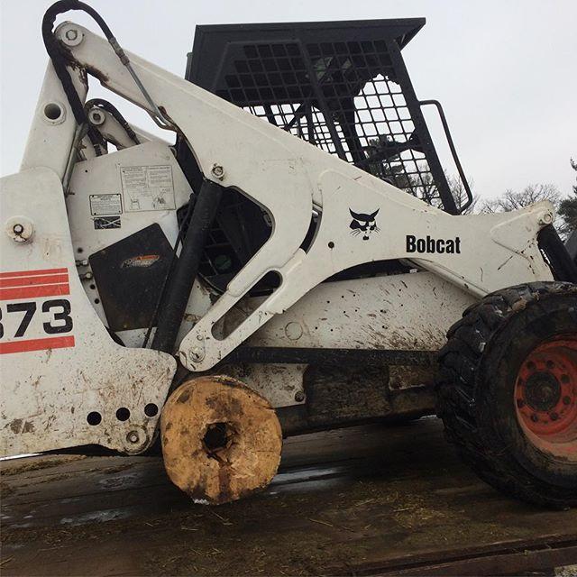 I sheared the axel off the bobcat, so I put a wood wheel on to get it loaded. I got so many flintstone jokes for this at the shop.