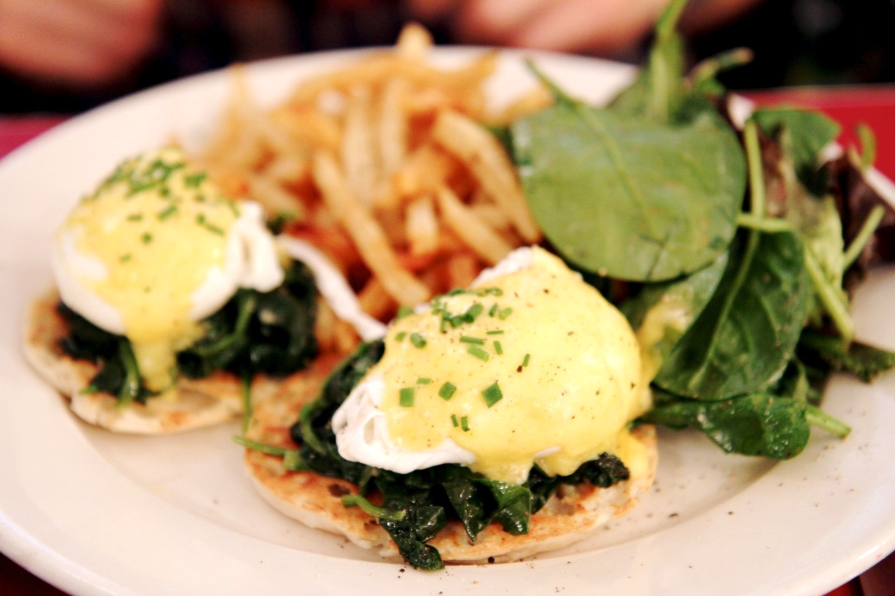 Eggs Florentine Sauteed Spinach On An English Muffin topped with hollandaise sauce
