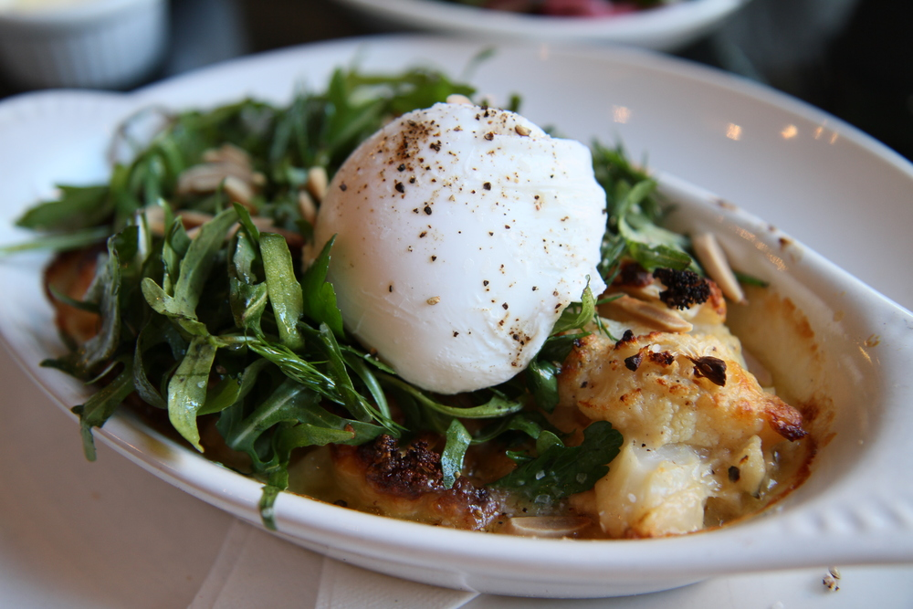 Cauliflower Gratin, Arugula Herb Salad, Toasted Almonds, and Poached Egg