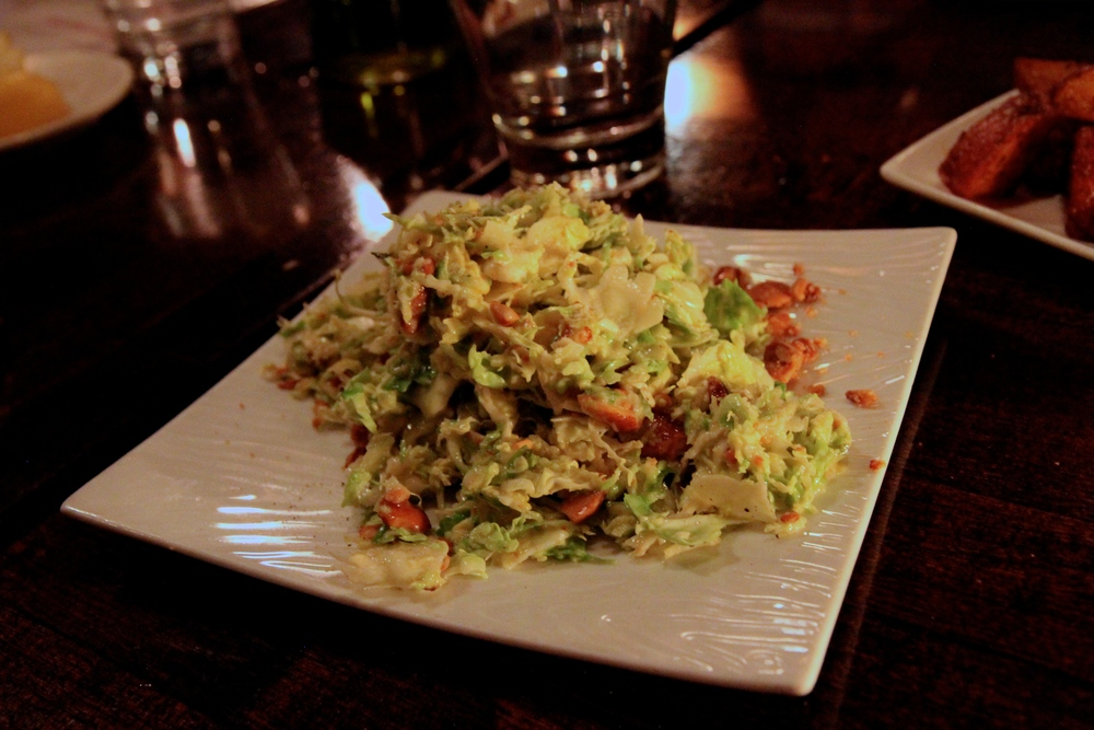 Brussel Sprout Salad with Marcona Almonds and Manchego Cheese.