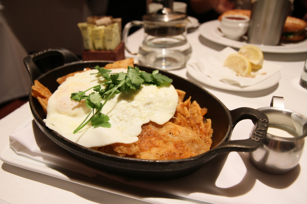 Chilaquiles | Fire Roasted Tomato Salsa, Two Eggs Over Easy, Queso Fresco, Creme Fraiche