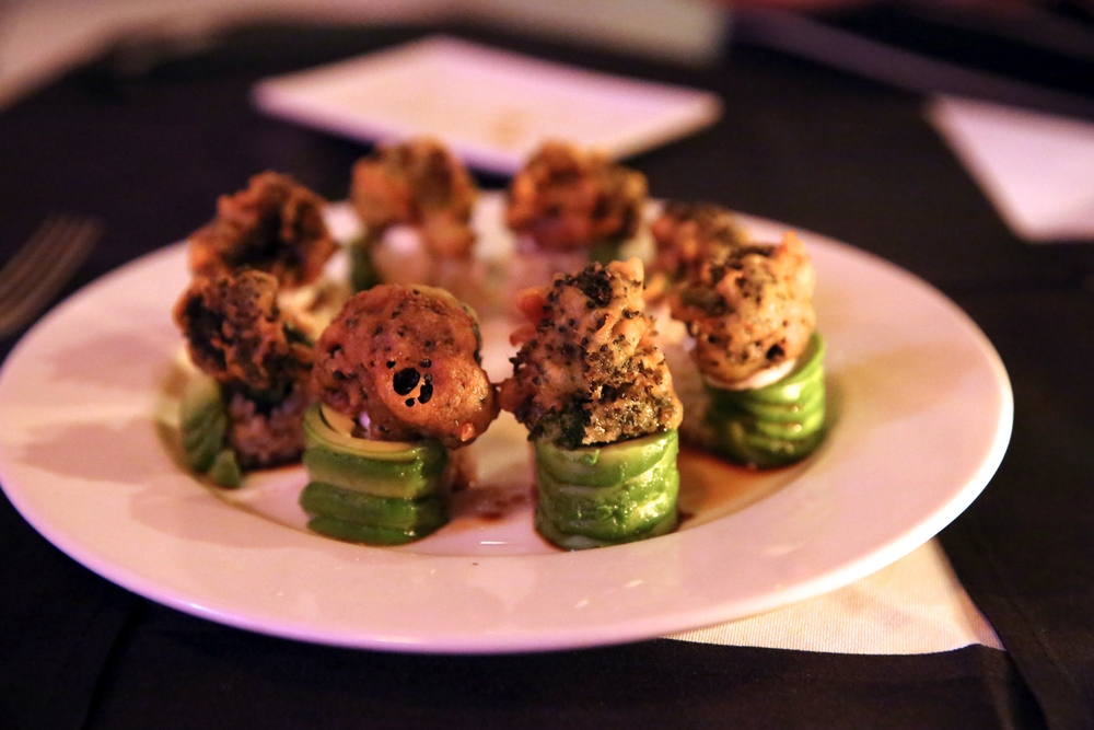 Green Forest Avocado wrapped asparagus carrot roll, tempura broccoli, yuzu mayo on top. Ginger yuzu ponzu sauce