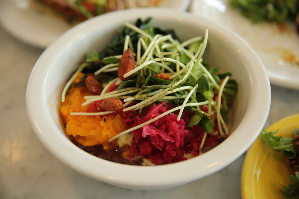 Bowl |  WHOLE macrobiotic bowl : braised butternut squash, adzuki beans, sea vegetables, seasonal sauteed greens, housemade kimchi, black sesame seed gomasio, garlic-tahini sauce, teriyaki almods, sunflower sprouts, sprouted probiotic brown rice or quinoa (or both!)