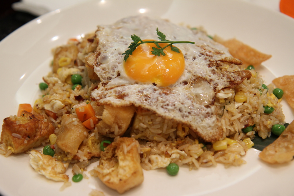 Nasi Goreng (vegetable) | Malaysian style fried rice with vegetables, tofu and fritters topped with egg