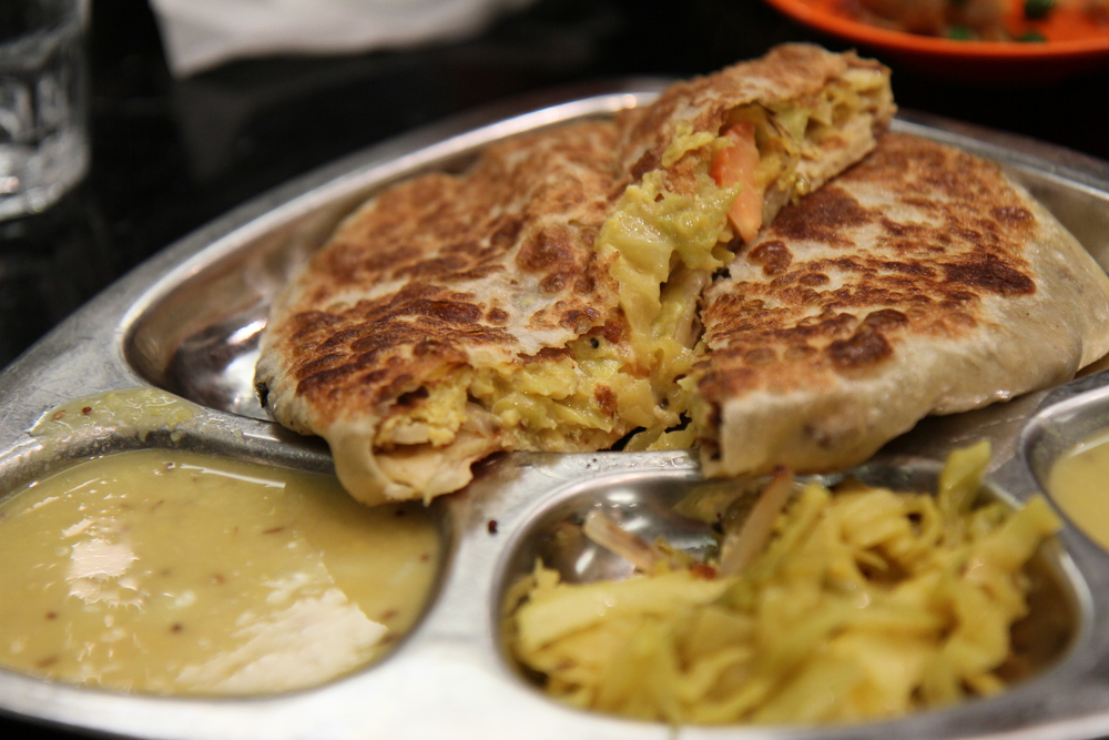 Vegetable Murtabak | onion, egg wrapped with roti served with dahl