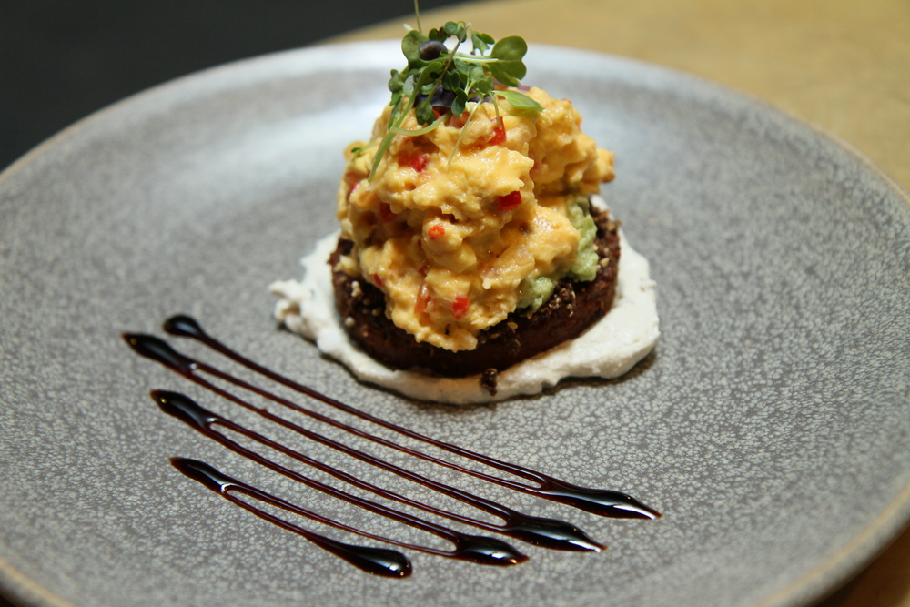Columbian Eggs | scrambled eggs, avocado, tomato salsa, spiced polenta and corn hash