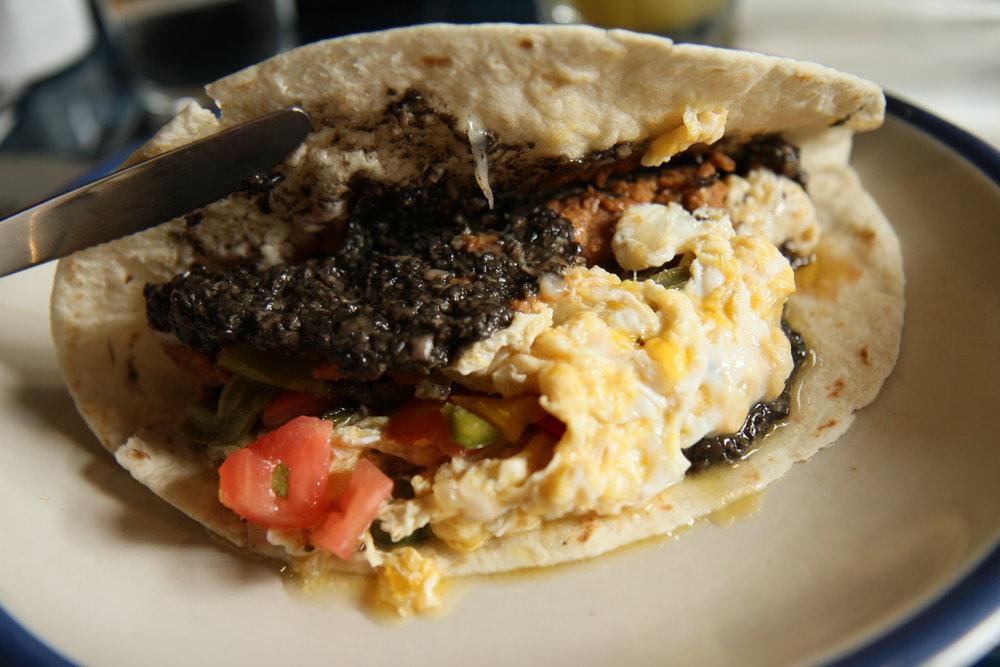 Baleada  | Honduran tortilla with pinto, cactus, smoked tetilla, salsa, scram and Mex truffle