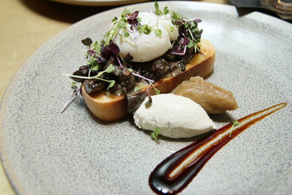 Mushroom on Toast | Portabello and Swiss Brown - mushrooms, poached eggs, smoked onion soubise, truffle cream, balsamic