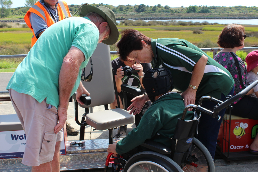 The seat can swivel to help with wheelchair transfers.  Leeola Wardlaw assists Tiarete Ranapia.