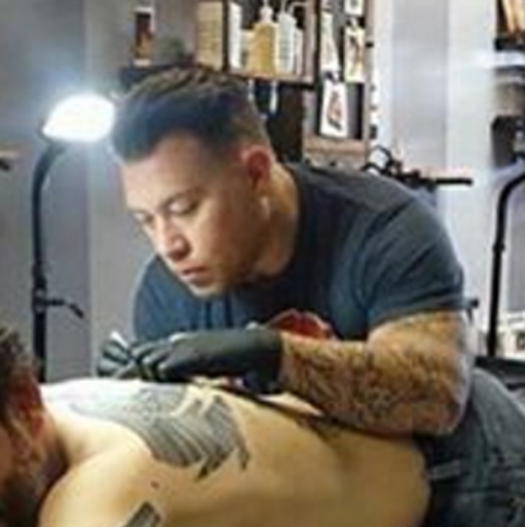 adam tattooing.jpg