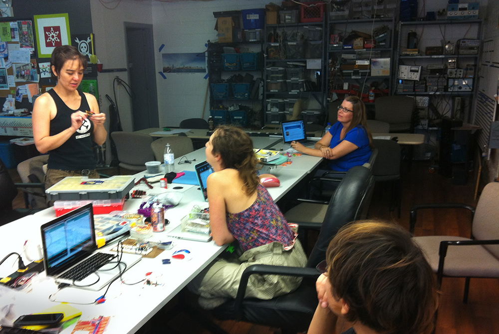 Host Jesse Seay, a Columbia College professor, shows a variety of different sensors and other electronic components to the drop-in participants.