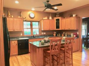 Gorgeous Colonial - 12283 W Sunset Lane, Greenfield $429,000.  MLS #1539489. Foxwood Crossings 5 BDRM, 3.5 BA, 3.5 car garage Colonial on wooded lot.Kitchen w/granite counters & hickory cabinets. Hickory flooring in the great room, kitchen & dinette. Large great room w/natural fireplace. 9 ft ceilings on main level. Huge master bedroom with walk in closet and spa like master bathroom. Newly installed carpeting on 2nd floor. Fantastic finished LL w/wet bar and fridge, gas fireplace, 5th bedroom, full bathroom, office, room to play or entertain or potential in-law suite.  Call Suzanne!