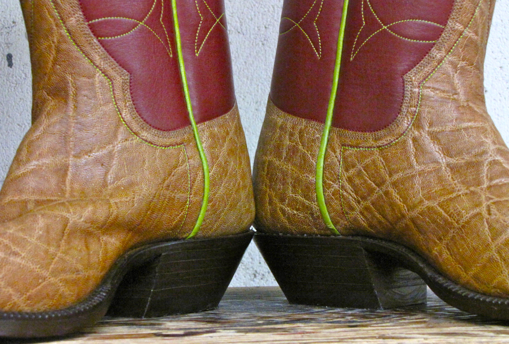 Custom made pair of sustainably and ethically sourced Elephant Leather Western Style Boots with green trim on seam.
