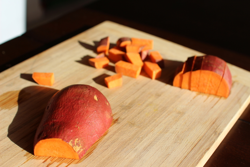 Chopping the sweet potatoes