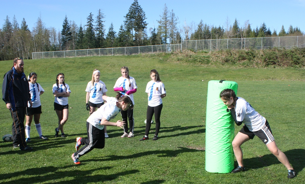 mADDIE cLUCAS IN THE 8TH GRADE WORKING ON HER TACKLING TECHNIQUE WITH NORTH STAR DIRECTOR OF RUGBY, CURRY HITCHBORN