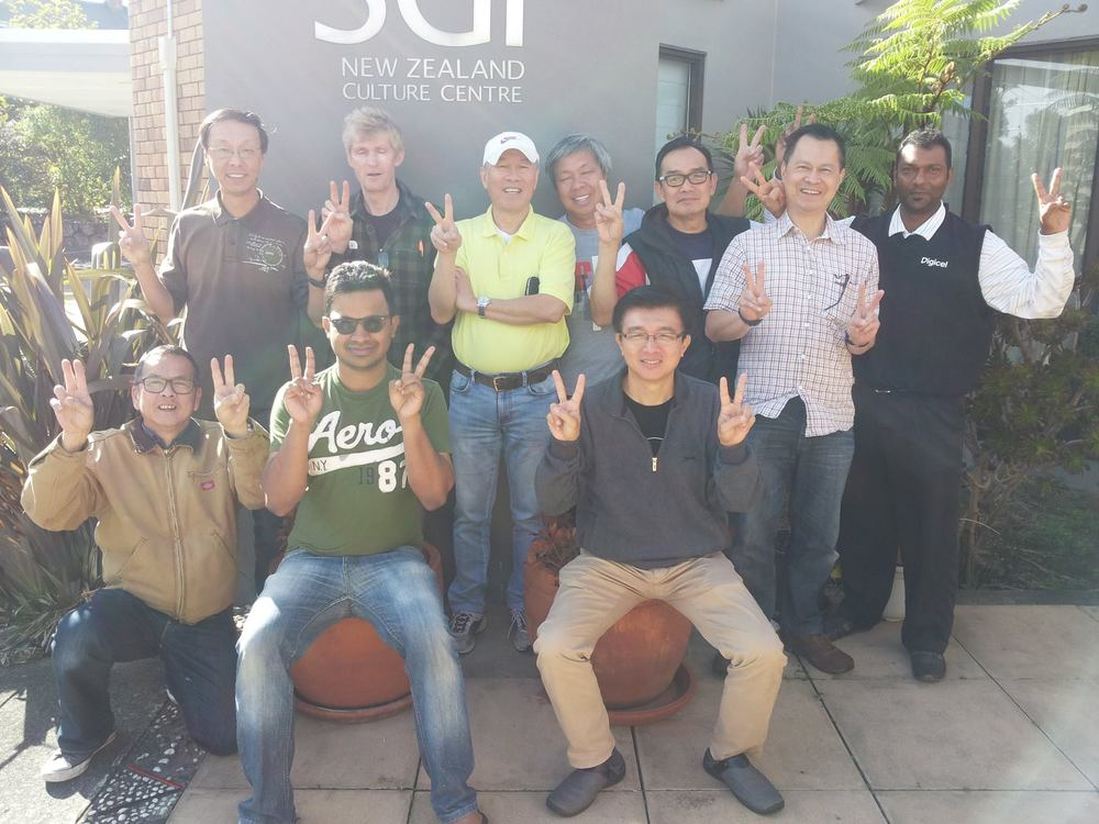Global Wave from SGI Auckland, New Zealand. No nukes - No carbon footprint. Abolish nuclear weapons and help save the environment. Waving goodbye to Nuclear Weapon by signalling Victory Sign