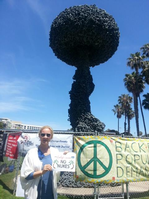 Joan Collins, Pacific LA Co-President of UNA-USA, waves goodbye to nuclear weapons at the Santa Monica Peace Rally.