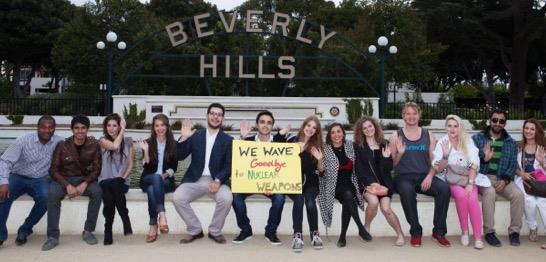Destiny Puzzanghera of UNA-USA Beverly Hills, CA Chapter and friends wave goodbye to nuclear weapons.