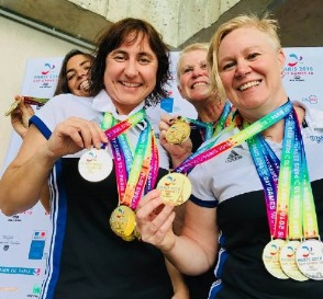 Our successful female swimmers from the 2019 Paris Gay Games. Back: Celia and Janet. Front: Susie and Megan