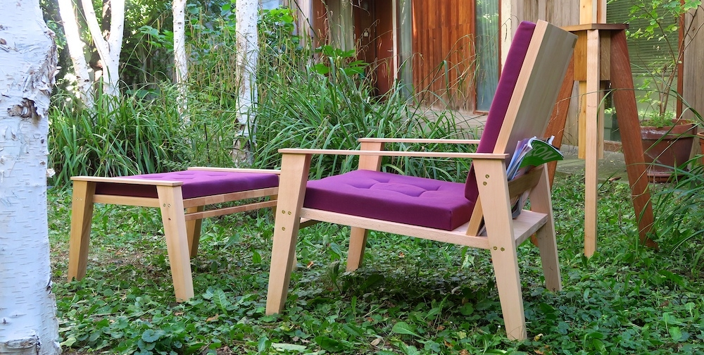 A nitsn lounge chair and ottoman made out of solid beech