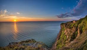 Capul Doloșman -  singura faleza stâncoasă  din zona litorală a României © lapensiuni.ro